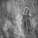 girl running through grass