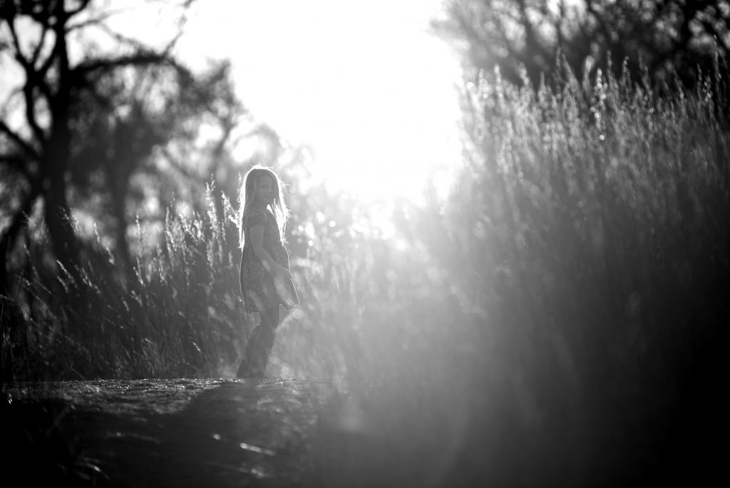 backlit girl and grass