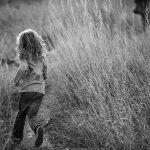 boy running through grass