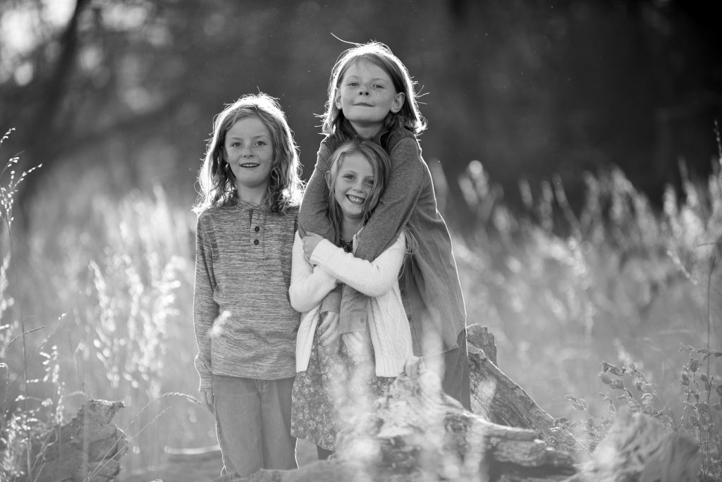 siblings along the poudre river in fort collins, colorado