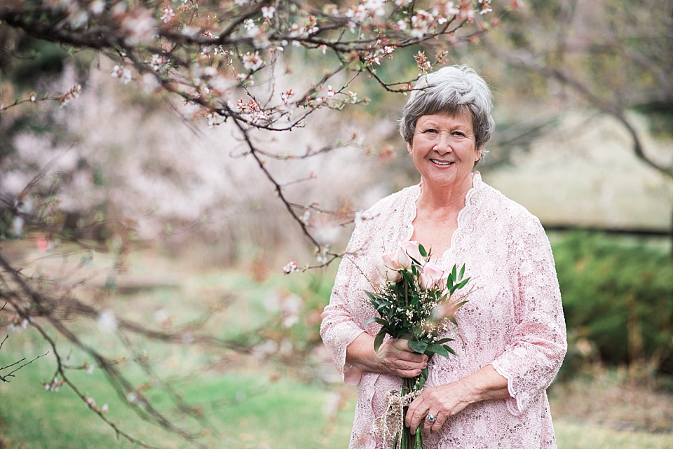 mature bride near spring blossoms