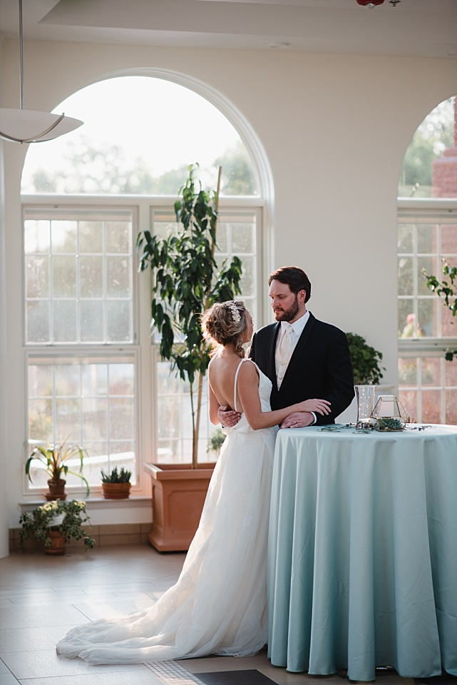 bride and groom talking at reception
