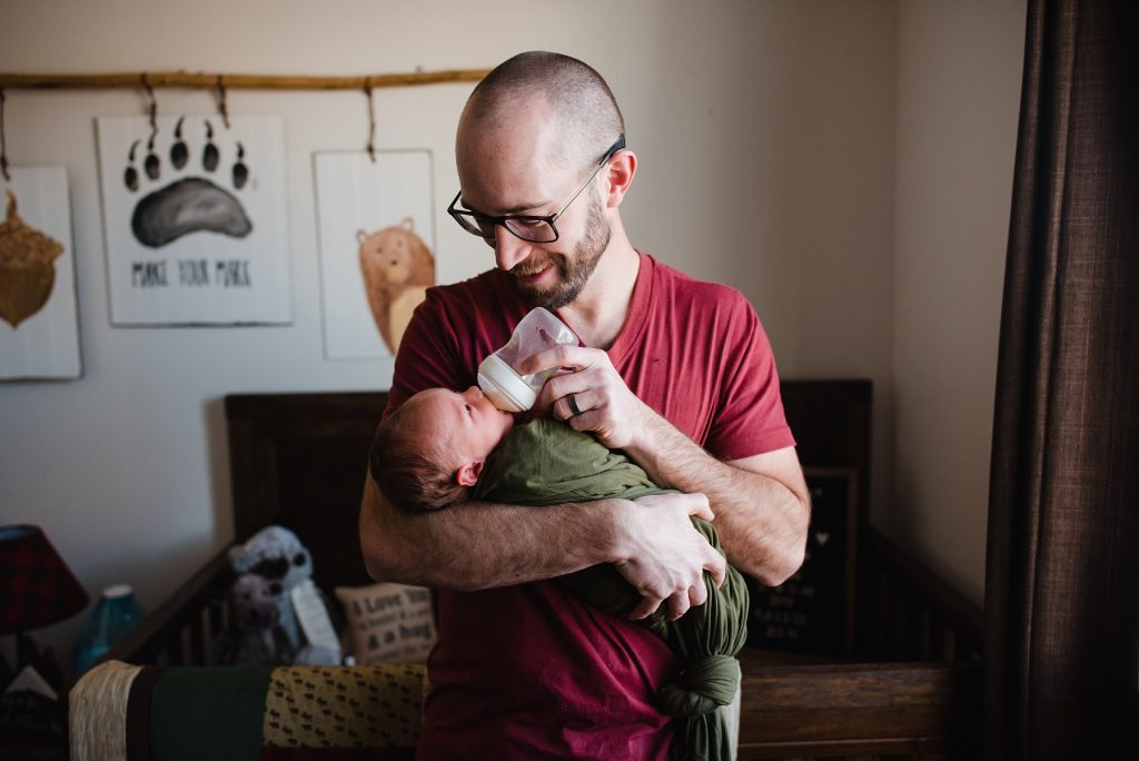 Dad feeding newborn with bottle