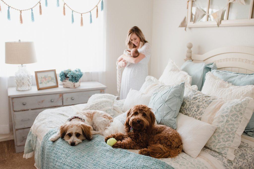 Mom holding baby in bedroom