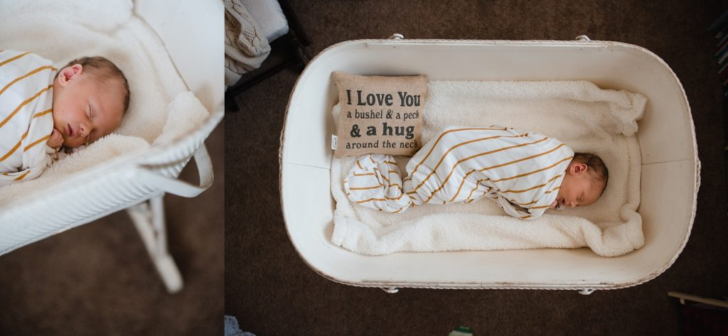 Baby laying in bassinet