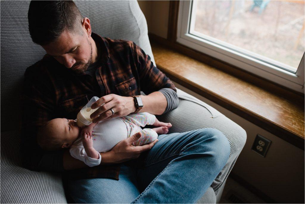 Dad feeding baby