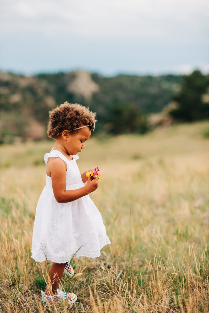 Girl walking through grass.