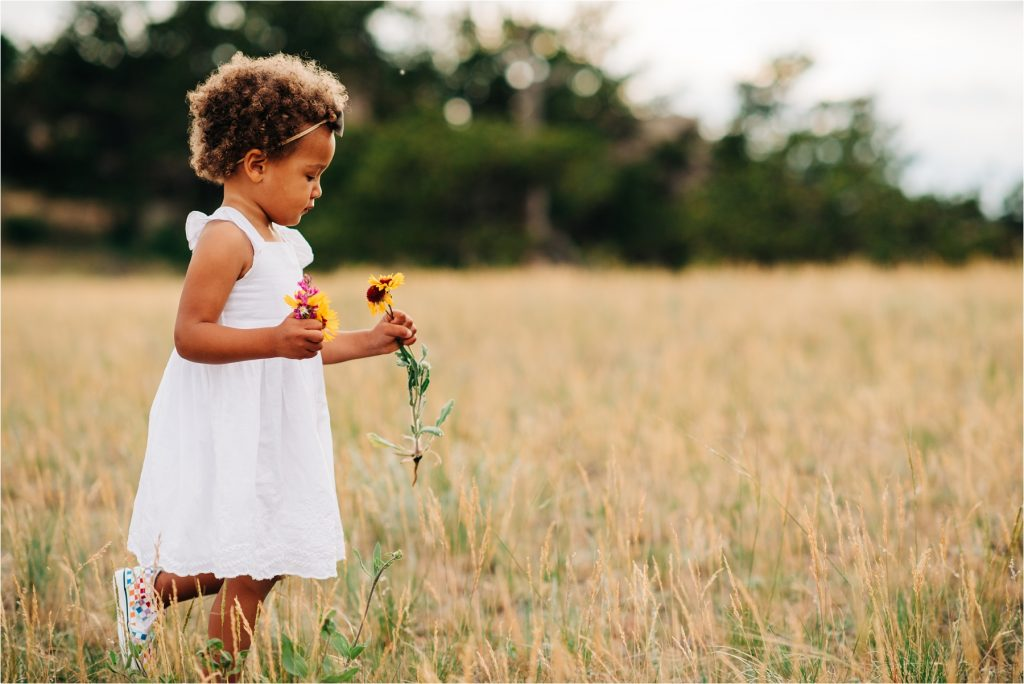 Girl walking with flowers.