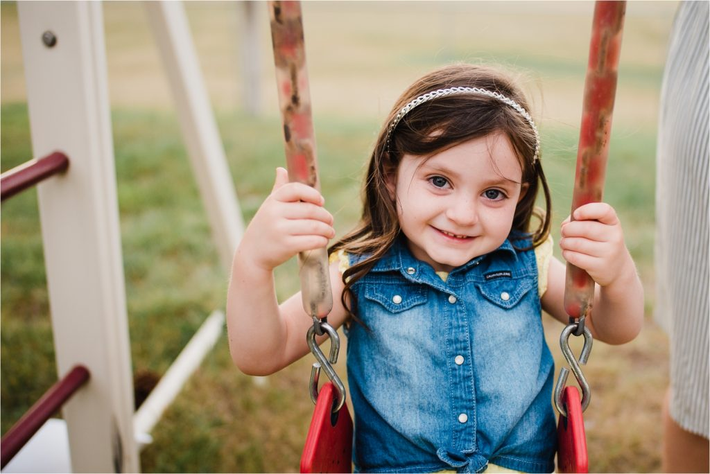 Girl smiling on swing